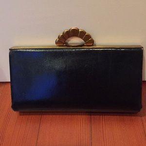 Vintage black leather clutch purse.